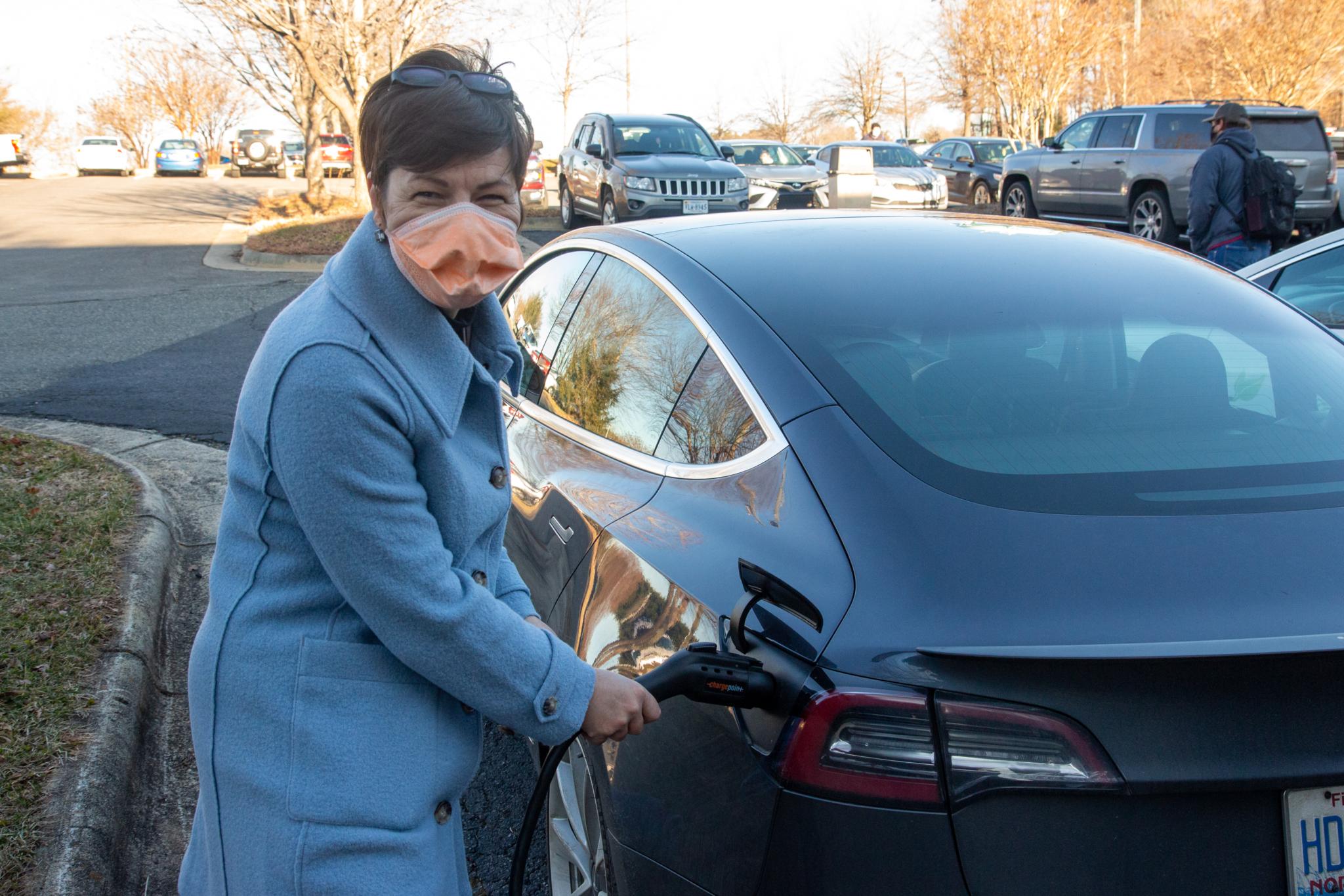 Dr. Maria Kriska charging car