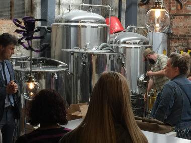 Dr. Jan Kriska teaching students about brewery equipment