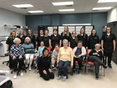 Cosmetology students are pictured with six special needs adults from Dunmore Plantation along with one student from Surry Central High School's Special Education Class.