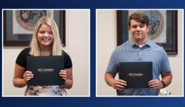 Students Ellie Grace Martin and Evan Scott Morris holding scholarships.