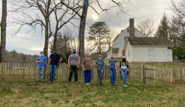 7 people in front of old house