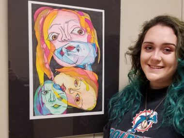 Student Mally Snow of Mount Airy is shown with her blind contour drawing with graphite and colored pencil.