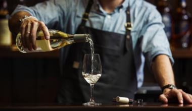 Man pouring wine at a vinyard bar