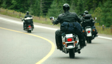Three motorcycles driving down a curved road.