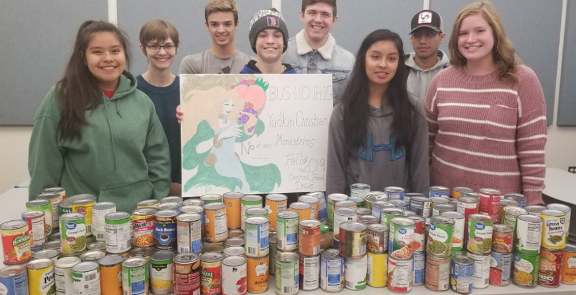 Students from Business 110 class photographed with can donation to Yadkin Christian Ministries.