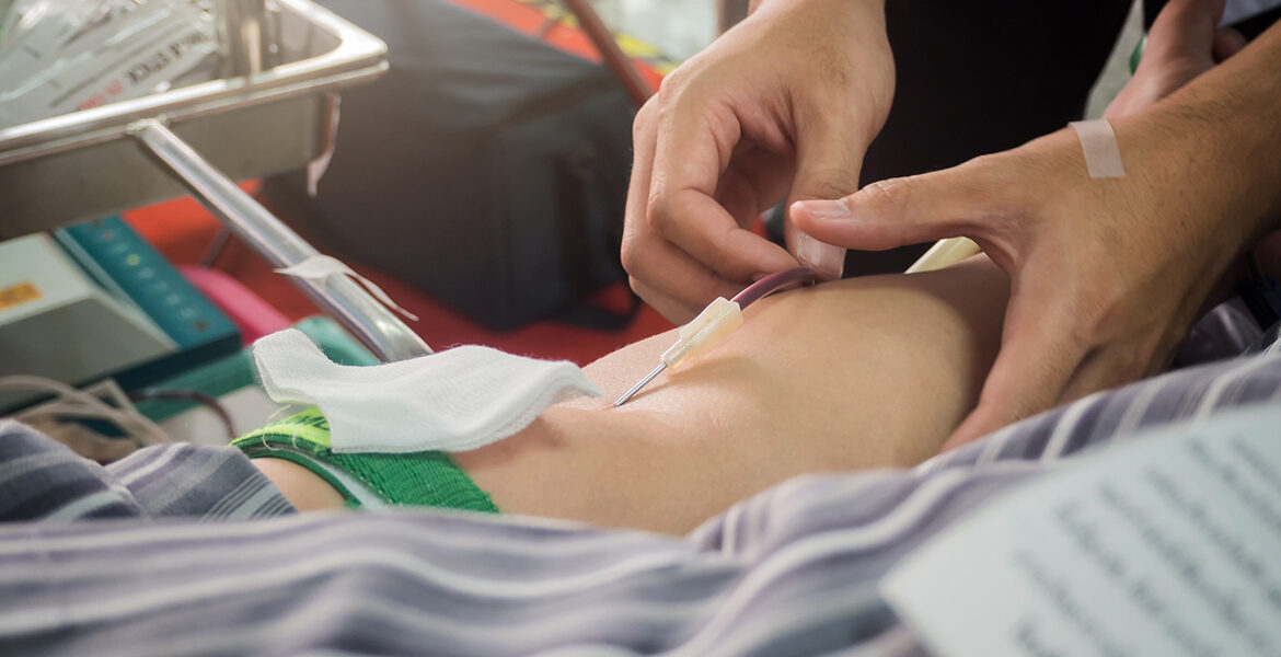 Blood Donor Making Donation In Hospital.