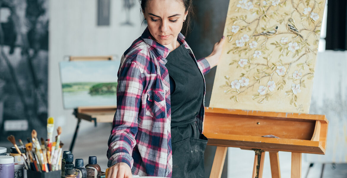 Floral pattern artwork. Artist talent and lifestyle. Attentive young woman choosing tool. Creative process.