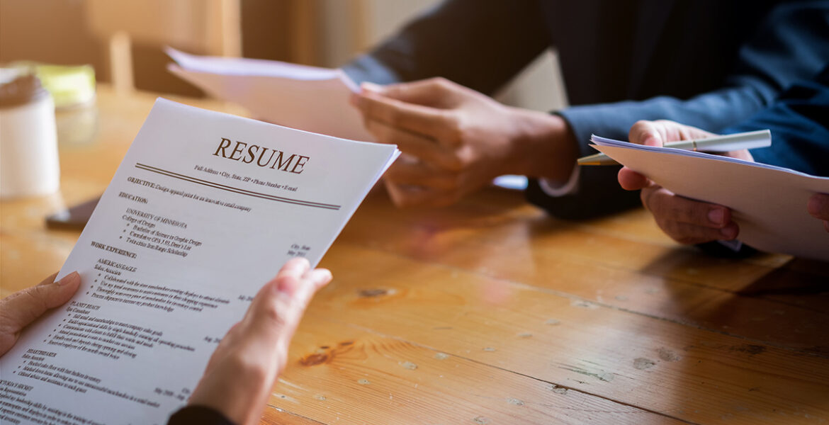 Interviewer reading a resume, Person submits job application,