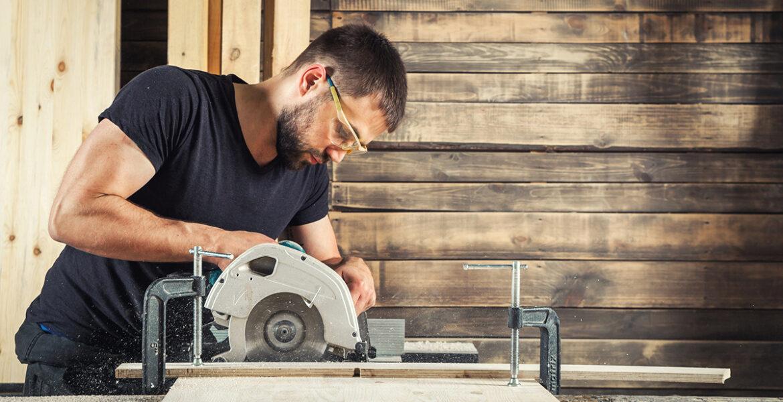 builder saws a board