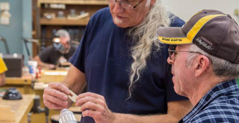 Instructor Joe Thrift teaching student
