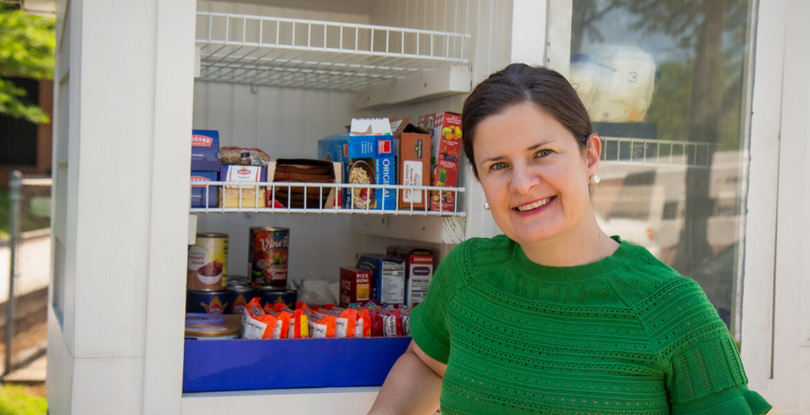 Kennette Thomas standing in front of Little Free Pantry