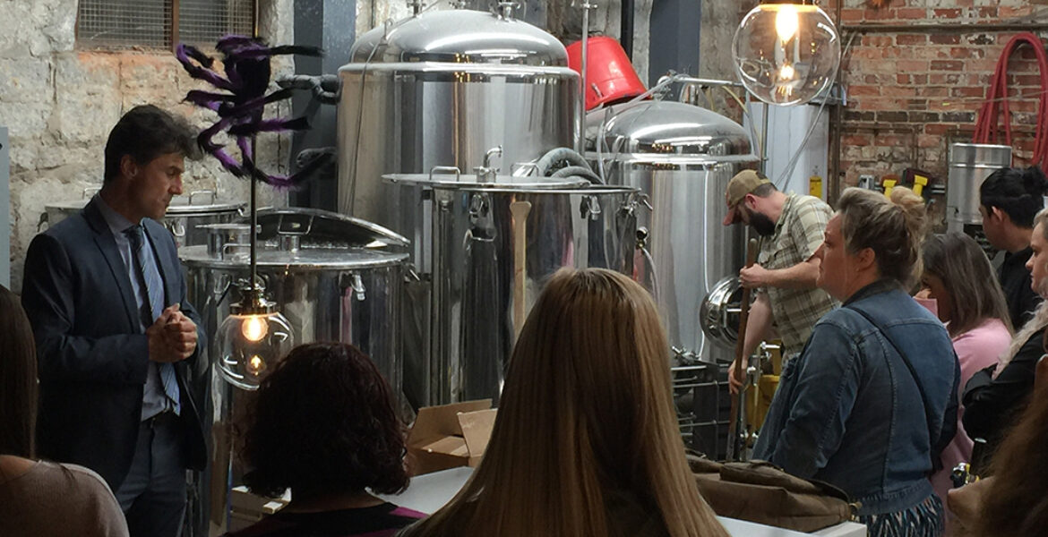 Dr. Jan Kriska teaching students about brewery equipment