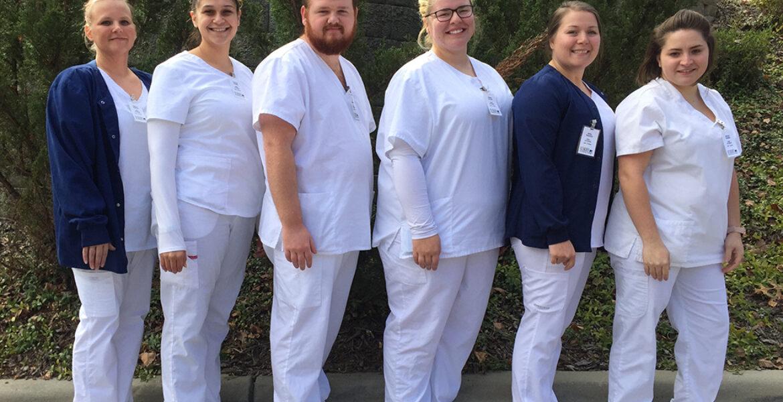 Six Nursing Assistant 1 Graduates smiling for photo
