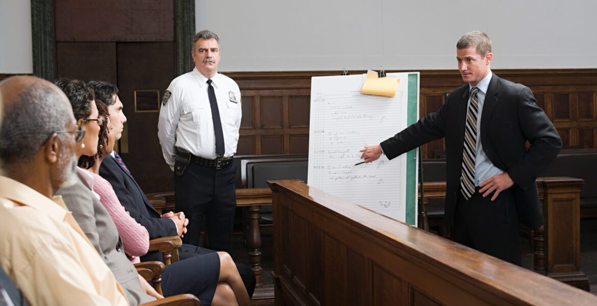 Courtroom photo of lawyer presenting to jury.