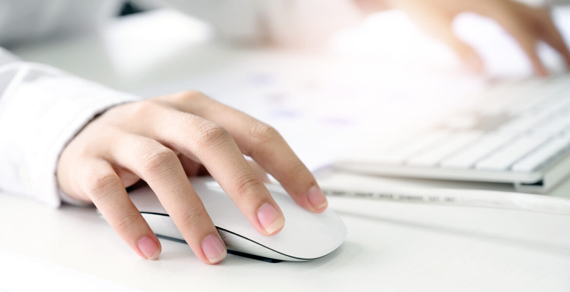woman's hand on computer mouse