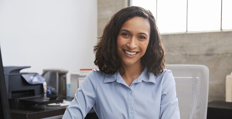 woman in office, sitting