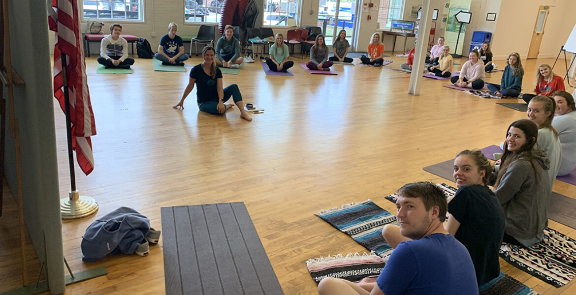 Eighteen students in the Yoga Class held at the Pilot Center